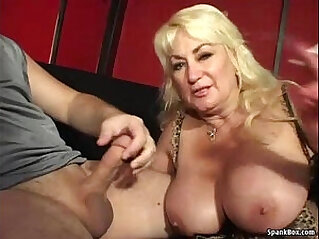 Busty mom gives blowjob and smokes cigarette at mom niche