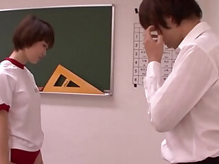 Young oriental schoolgirl blowing teacher