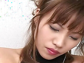 Horny Japanese AV model strips out of her slutty outfit to toy her pussy