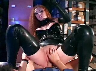 Sexy redhead fucked in shiny black latex