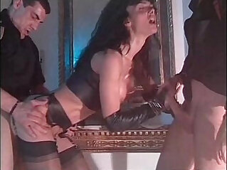 Vintage porn video with Venere Bianca in latex dress fucked by two men