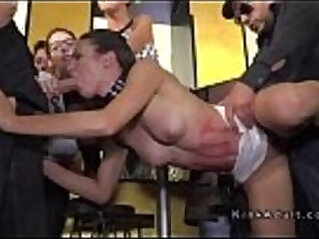 Public slave works cock in crowd