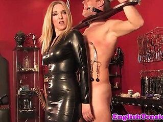 British dominatrix with gagged and bound sub