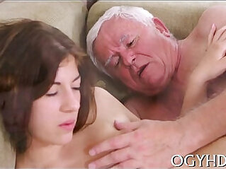 Young beauty gives a blow to old dick