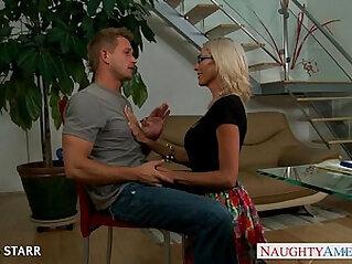 Blonde lesbian babe in glasses Emma Starr gives titjob