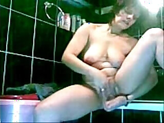 Hidden cam. Great view of my mom masturbating in bath room